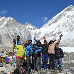 Group at the Everest Base Camp with the mountain itself in the background.