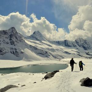 The beautiful emerald green lake on the Kalihani glacier.